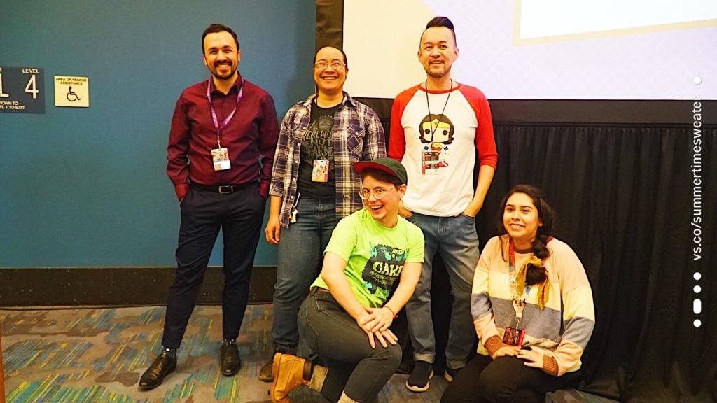 A group photo of the Queering Comics Panel