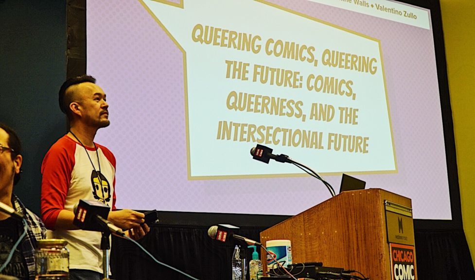 Moderator Mark R. Martell standing in front of a screen that displays the title of the panel.